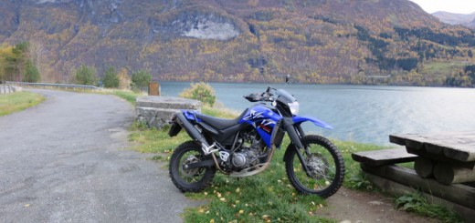 Motorcycle break Scandinavian lake